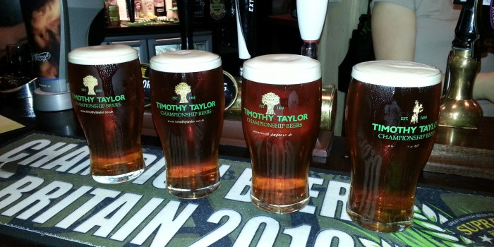 4 pints of Timothy Taylors Landlord poured at the Strugglers Inn in Lincoln