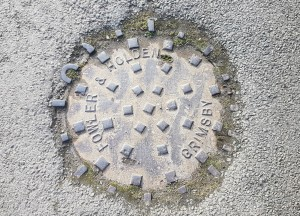 Manhole cover out of Grimsby by Market Rasen